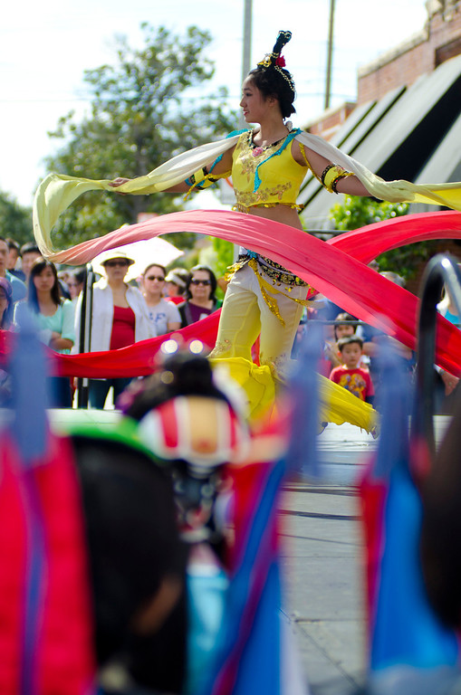 . A performer twirls for the crowd on stage at the 22nd Annual Alhambra Lunar New Year Celebration in Alhambra, Calif., Saturday, Feb. 16, 2013. The festival included food, rides, games and entertainment. (SGVN/Correspondent photo by Anibal Ortiz)