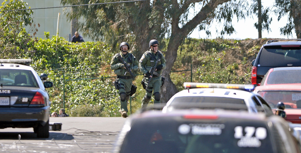 . SWAT team members in El Segundo during a hostage situation at the Popcornopolis offices near El Segundo Blvd. Armed female employee took another employeee hostage which ended peacefully after about 4 hours. Photo by Brad Graverson 4-16-13