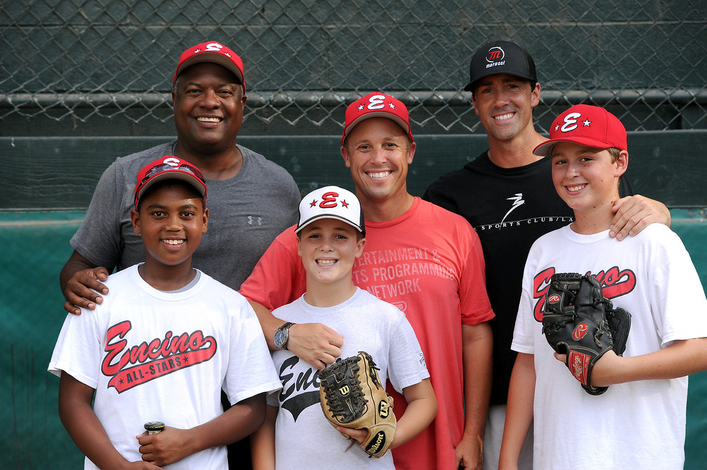 . Encino\'s 11-under all-star baseball head coach Kevin Dicker, center, with his son Jake Dicker, and assistant coach Rodney Peete, left, with his son Robinson Peete, and assistant coach Ryan Stromsborg and son Tyler Stromsborg. (Michael Owen Baker/L.A. Daily News)