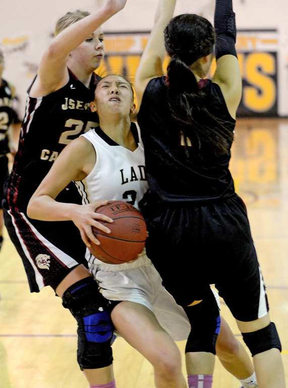 . BIshop Montgomery\'s Sophia Song (24) gets sandwiched, drawing a foul, by JSerra\'s Megan House (25) and Coco Miller (1) in a CIF Division IV-AA quarterfinal game Wednesday night in Torrance. 20130220 Photo by Steve McCrank / Staff Photographer
