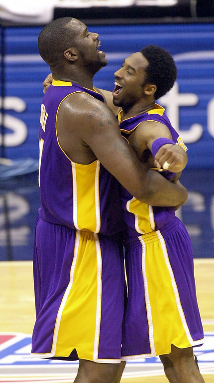 . Los Angeles Lakers center Shaquille O\'Neal, left, and teammate Kobe Bryant embrace at mid court during the final second of their victory over the  San Antonio Spurs in game two of the Western Conference Finals in San Antonio, Texas, Monday, May 21, 2001. Los Angeles won 88-81 and now have a 2-0 series lead. (AP Photo/Eric Gay)