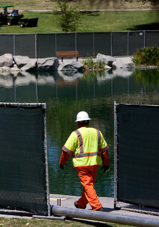 Description of . Crews prepare to drain the lake at Red Hill Park in Rancho Cucamonga, CA, Monday, May 12, 2014. (Photo by Jennifer Cappuccio Maher/Inland Valley Daily Bulletin)