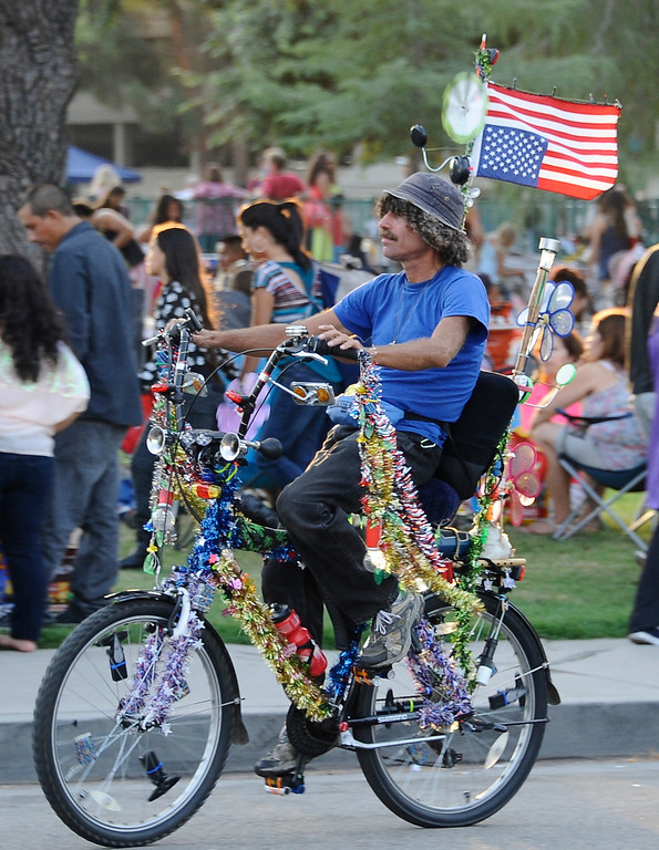 . July 4,2013 Woodland Hills. People show their colors during the July Fourth Fireworks Extravaganza: Keyes Automotive Group co-sponsors the event with music by the Los Angeles Pierce Symphonic who performed  Photo by Gene Blevins/LA Daily News