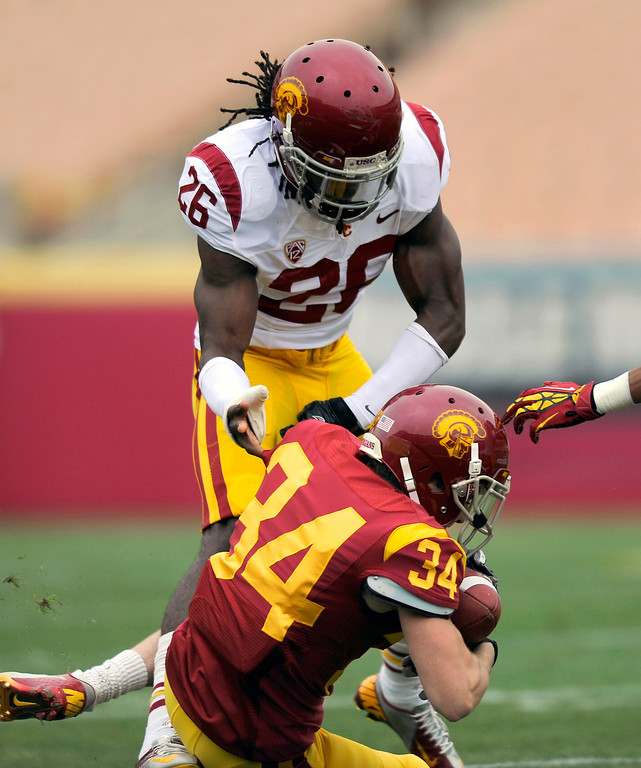 . Safety Josh Shaw puts a hit on WR Cody Skene at USC\'s Spring Football Game. (Michael Owen Baker/Staff Photographer)