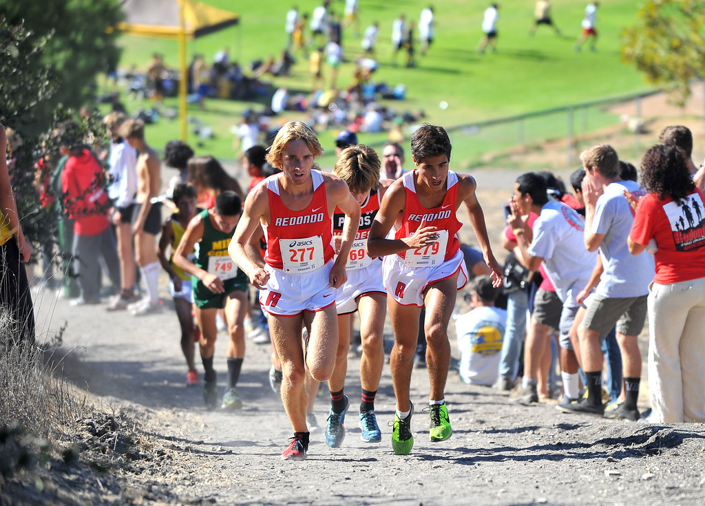 . Peninsula High hosted a Bay League cross country meet in Palos Verdes Estates, CA on Thursday, September 26, 2013.  Redondo runners lead the pack as they run up the large hill. (Photo by Scott Varley, Daily Breeze)