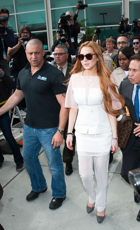 . LOS ANGELES, CA - MARCH 18:  Lindsay Lohan leaves after her trial for allegedly lying to police after a car crash, reckless driving and violating her probation for a 2011 jewelry theft conviction at Airport Branch Courthouse of Los Angeles Superior Court March 18, 2013 in Los Angeles, California. Lohan pleaded no contest to two counts in a plea deal and sentenced to 90 days in locked rehab, 30 days community labor and 18 months psychotherapy.  (Photo by Valerie Macon/Getty Images)