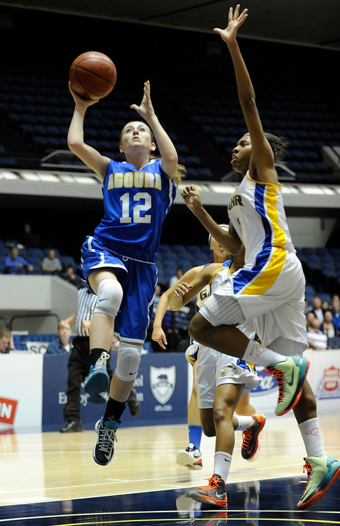 . Agoura #12 Natalie Bradley goes up against Gahr #3 Jewelyn Sawyer. Agoura defeated Gahr 60-39 in the CIF-SS Division III-AAA Girls Basketball Championship at the Anaheim Convention Center in Anaheim, CA 2/23/2013(John McCoy/Staff Photographer)
