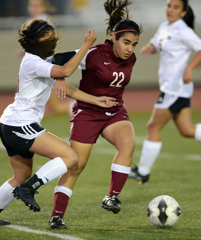 . Downey\'s Tara Kazimi (22) fends-off Torrance\'s Kealani Tiratira (13) in a CIF SS Division IV quarterfinal game Thursday at Zamperini Field. Downey won the game 3-1. 20130221 Photo by Steve McCrank / Staff Photographer
