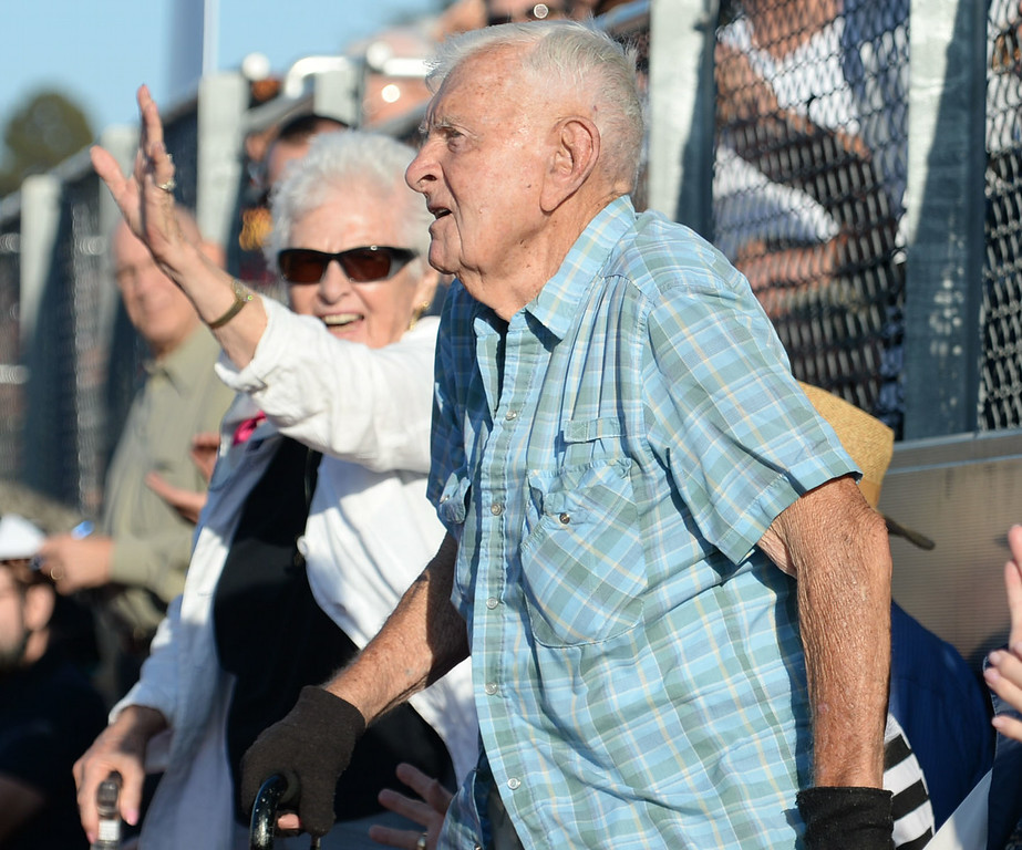 . Torrance High classmates of Zamperini wave to the crowd during a  memorial for Torrance legend Louis Zamperini who died earlier this month Thursday, July 31, 2014, Torrance, CA.  Zamperini was an Olympian, WWII bomber pilot and Japanese POW. A book by Laura Hildebrand titled Unbroken documented his life and a movie directed by Angelina Jolie will be released in December. Photo by Steve McCrank/Daily Breeze