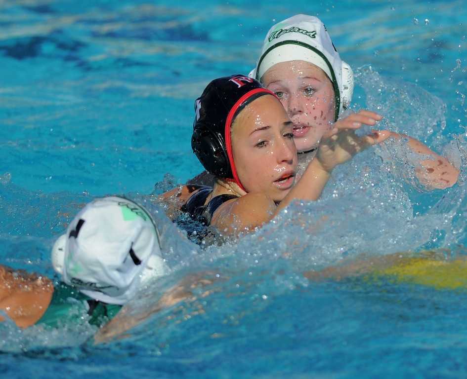 . 02-16-2012--(LANG Staff Photo by Sean Hiller)- Palos Verdes girls water polo defeated Upland 10-8 in Saturday\'s CIF Southern Section Division III quarterfinal at Palos Verdes High School. PV\'s Ellie D\'Ambra, center, is heavily guarded by Upland\'s Amanda Jarvis (7), left, and Jessica Sapp (13).