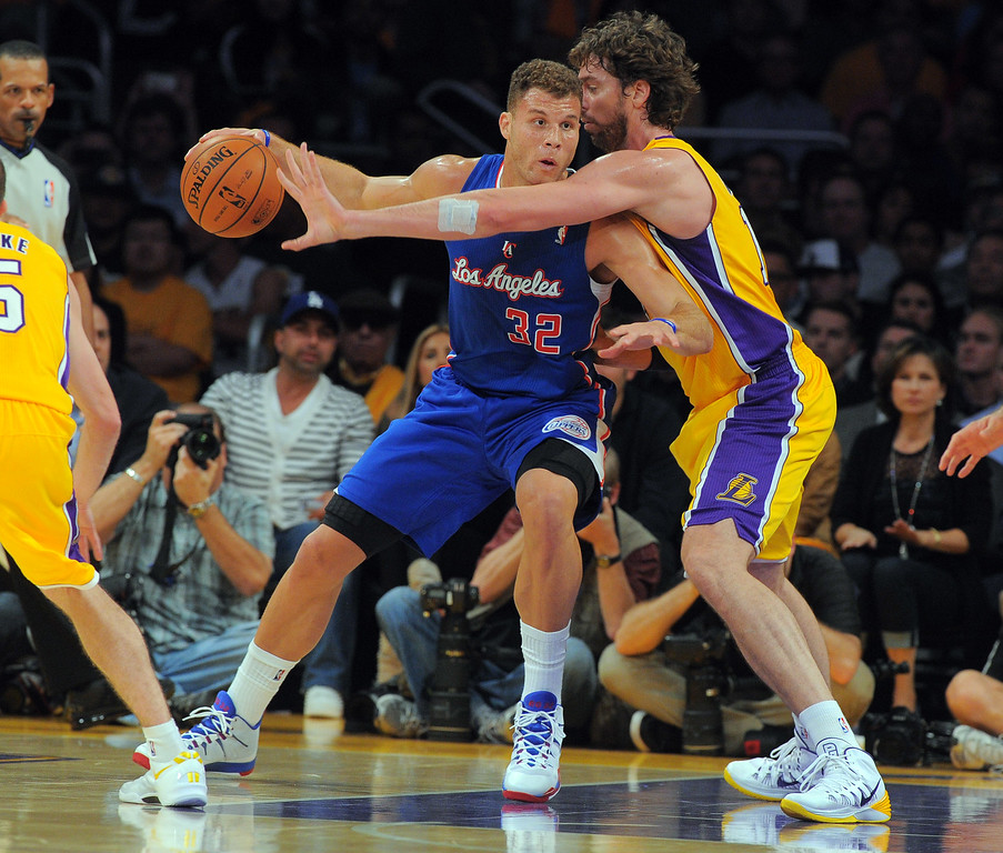 . Clippers Blake Griffin tries to work to the basket around Pau Gasol in the NBA season opener between the Lakers and Clippers at Staples Center in Los Angeles, CA on Tuesday, October 29, 2013.   (Photo by Scott Varley, Daily Breeze)