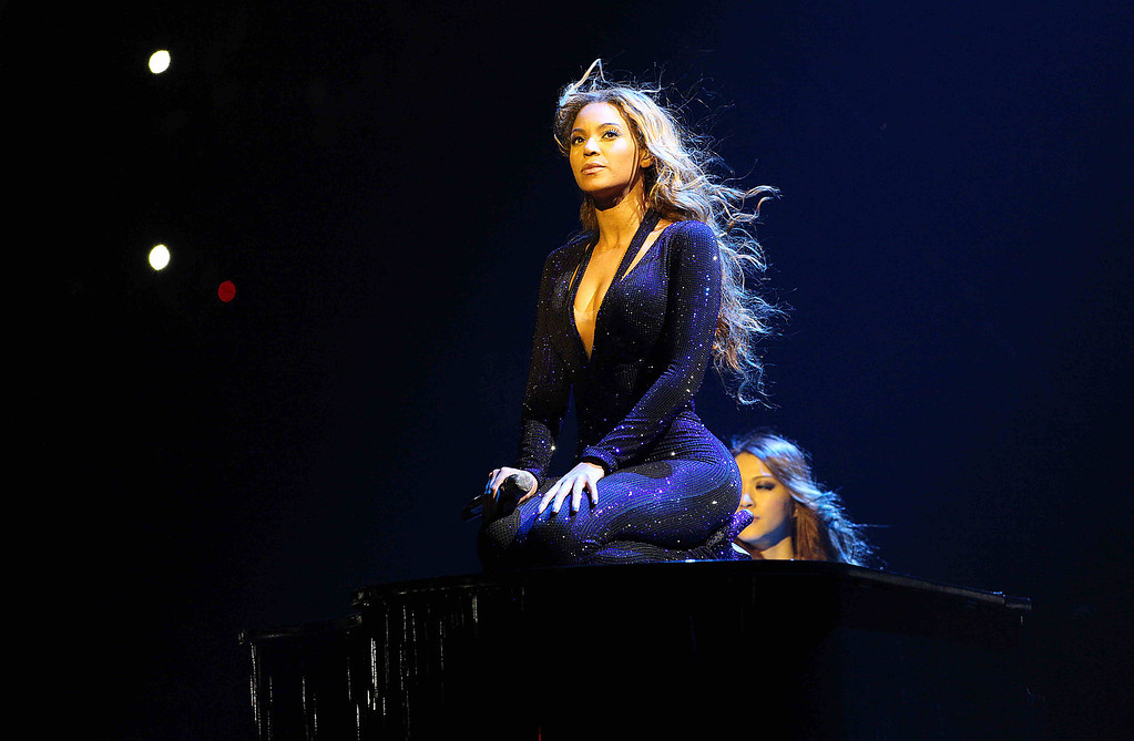 """. IMAGE DISTRIBUTED FOR PARKWOOD ENTERTAINMENT - Singer Beyonce performs on the opening night of her \""""Mrs. Carter Show World Tour 2013\"""", on Monday, April 15, 2013 at the Kombank Arena in Belgrade, Serbia. Beyonce is wearing a cobalt blue hand beaded jumpsuit by designer Vrettos Vrettakos. (Photo by Yosra El-Essawy/Invision for Parkwood Entertainment/AP Images)"""