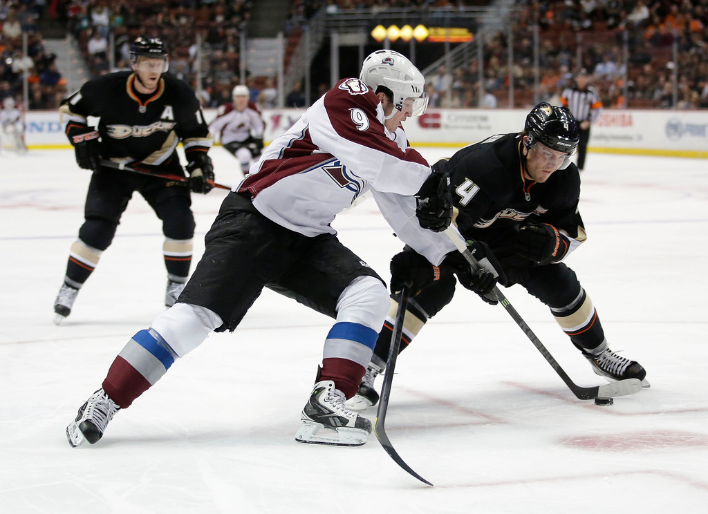 . Colorado Avalanche\'s Matt Duchene, left, is defended by Anaheim Ducks\' Cam Fowler during the first period of an NHL hockey game in Anaheim, Calif., Wednesday, April 10, 2013. (AP Photo/Jae C. Hong)