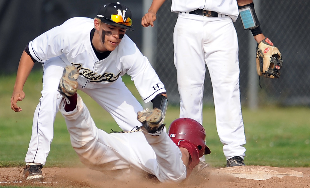 Description of . Northview third baseman Adrian Sabatino tags out Covina's Brian Maag at third base in the third inning of a prep baseball game at Northview High School on Tuesday, March 19, 2013 in Covina, Calif. Covina won 4-3.  (Keith Birmingham Pasadena Star-News)
