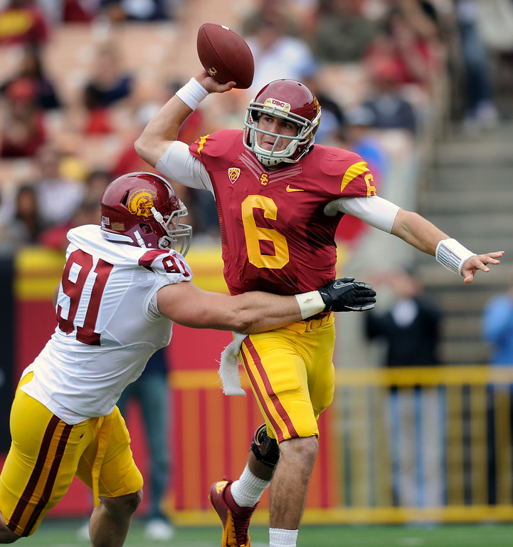 . QB Cody Kessler passes under pressure from DE Morgan Breslin during USC\'s Spring Football Game at the L.A. Memorial Coliseum, Saturday, April 13, 2013. (Michael Owen Baker/Staff Photographer)