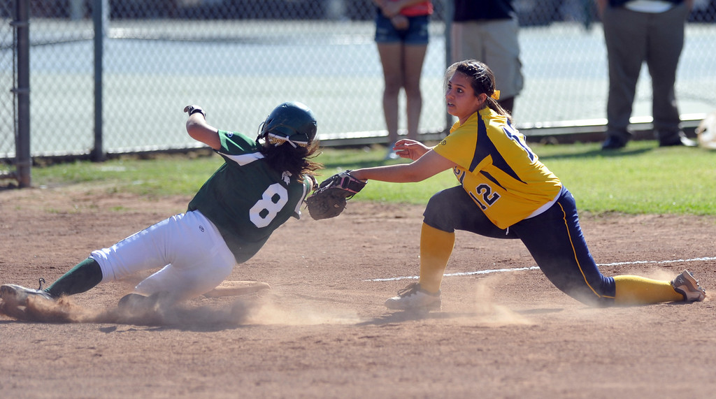 Description of . Montebello pitcher Evelyn Hernandez (#12) tags out Schurr's Breanna Bolanos (#8) at third base in their Almont League girls softball game at Montebello High School on Thursday April 18, 2013. Montebello beat Schurr 10-8. (SGVN/Staff Photo by Keith Durflinger)
