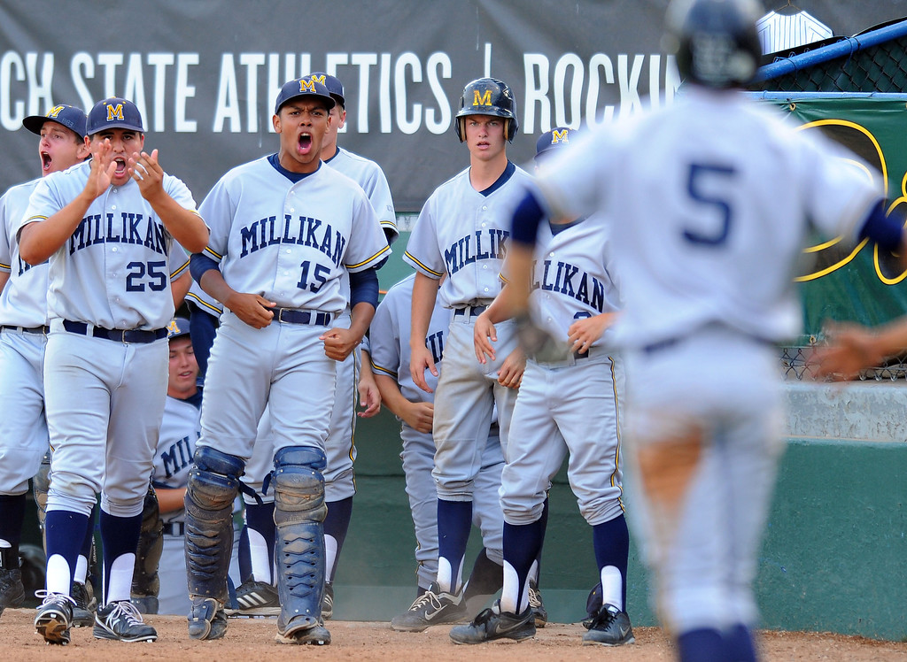 . LONG BEACH - 05/01/13 - (Photo: Scott Varley, Los Angeles Newspaper Group)  Lakewood vs Millikan baseball at Blair Field. Millikan players celebrate after Jacob Hughey, right, scores in the first inning.