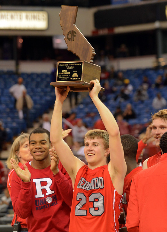 . Redondo Union High School\'s Derek Biale hoists the CIF State Championship trophy after defeating College Park High School during the Division II 2013 CIF State Basketball Championships at Sleep Train Arena, in Sacramento, Ca March 23, 2013.  Redondo won the game 54-47.(Andy Holzman/Los Angeles Daily News)