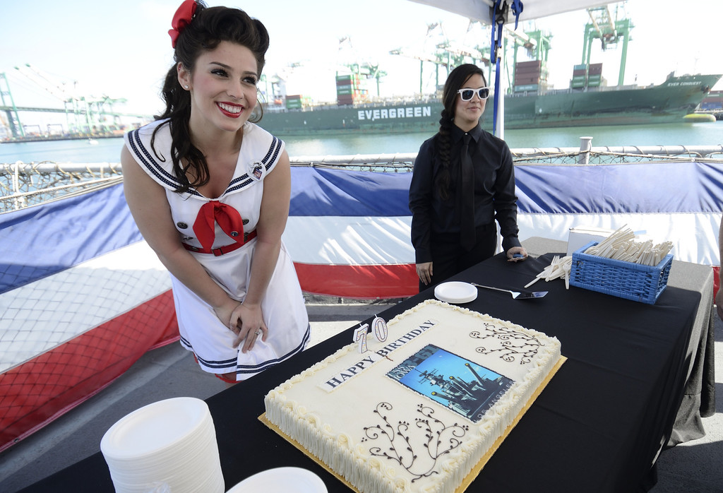 . SAN PEDRO, CALIF. USA -- Pin-up girl Jamie Beman with a cake during the 70th. birthday celebration of the USS Iowa in San Pedro, Calif. on February 17, 2013. Photo by Jeff Gritchen / Los Angeles Newspaper Group
