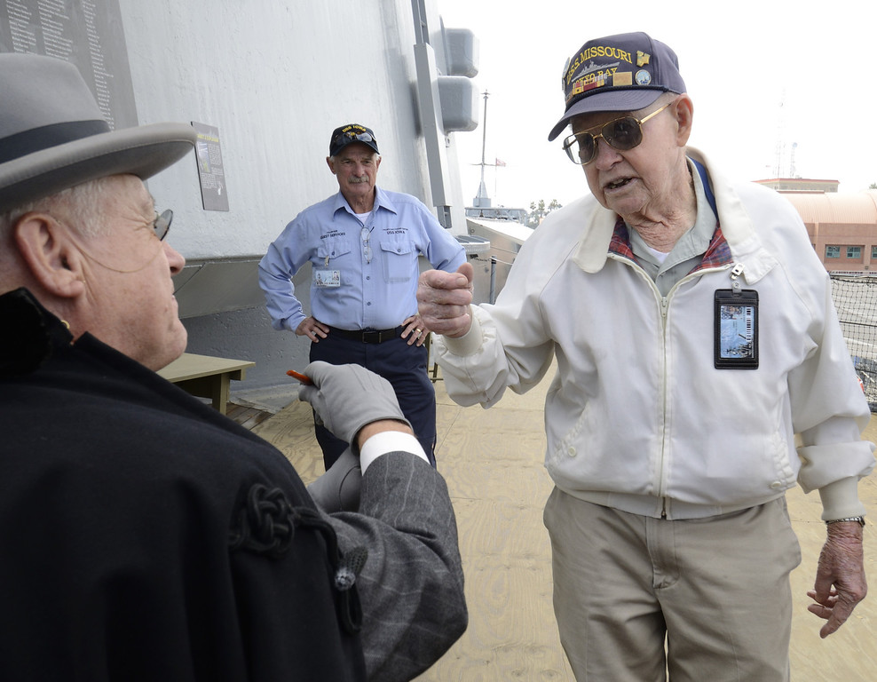 . SAN PEDRO, CALIF. USA --Navy veteran Ernie Thompson chats with a Franklin Delano Roosevelt impersonator during the 70th. birthday celebration of the USS Iowa in San Pedro, Calif. on February 17, 2013. Photo by Jeff Gritchen / Los Angeles Newspaper Group