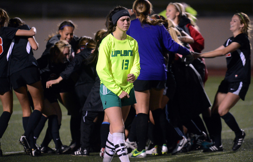 Description of . Upland (green) vs San Clemente girls varsity soccer CIF-SS Division 1 first round playoff game action Thursday, February 14, 2013, at Upland High School in Upland. Upland was eliminated by San Clemente 1-0 in overtime. Jennifer Cappuccio Maher/Staff Photographer