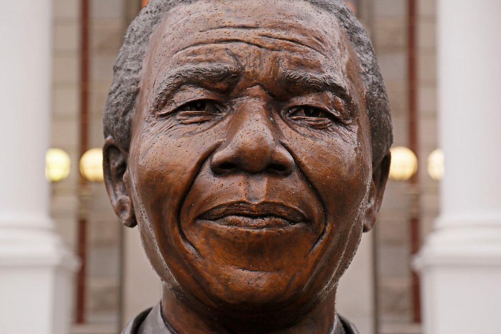 . Raindrops on the statue of  former South African President Nelson Mandela outside parliament in Cape Town, South Africa, Friday, July 18, 2014. South Africans marked the late Nelson Mandela\'s birthday on Friday with charitable acts in honor of the former president, whose death in December prompted a global outpouring of tributes. Organizers had urged people to perform acts of charity for 67 minutes, symbolizing the anti-apartheid leader\'s 67 years of public service. (AP Photo/Schalk van Zuydam)