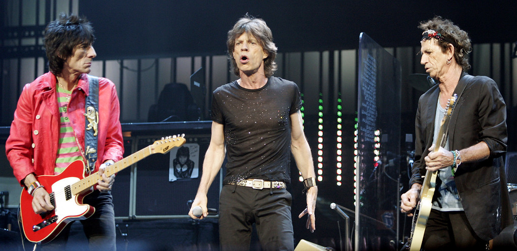 ". Mick Jagger, center, of the Rolling Stones sings ""She\'s So Cold\"" with Keith Richards, right, and Ron Wood Tuesday, Sept. 13, 2005, in New York\'s Madison Square Garden during their Bigger Bang World Tour. (AP Photo/Jeff Christensen)"