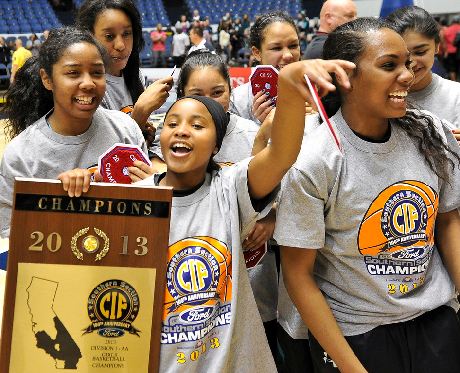 Description of . Santiago High School celebrates after defeating Etiwanda in the CIF-SS Div. I-AA Girls Basketball Championship game at the Anaheim Convention Center on Friday, Mar. 1, 2013. Etiwanda was defeated by Santiago 70-65. (Rachel Luna / Staff Photographer)