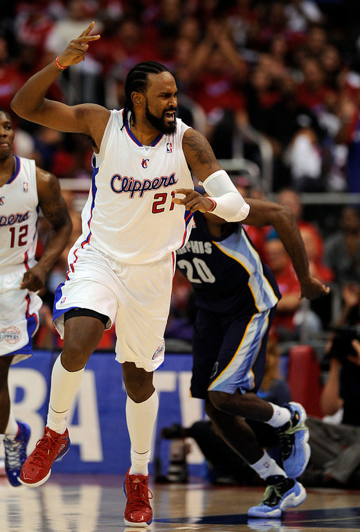 Description of . The Clippers' Ronny Turiaf #21 reacts after scoring a basket  during their first round Western Conference Playoff game against the Grizzlies at the Staples Center in Los Angeles Saturday, April 20, 2013. The Clippers beat the Grizzlies 112-91. (Hans Gutknecht/Staff Photographer)