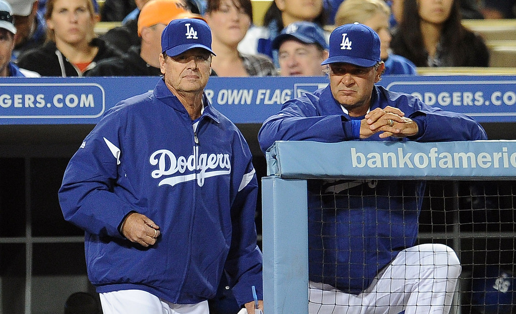 . Los Angeles Dodgers manager Don Mattingly, right with pitching coach Rick Honeycutt looks on as starting pitcher Clayton Kershaw (not pictured) gives-up a run in the sixth inning of their baseball game against the San Diego Padres on Wednesday, April 17, 2013 in Los Angeles.   (Keith Birmingham/Pasadena Star-News)