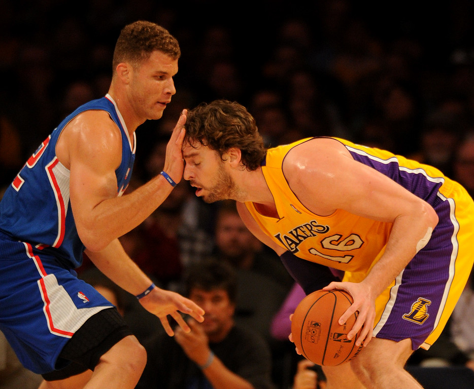 ". ""Clippers#32 Blake Griffin fouls Lakers#16 Pau Gasol in the first quarter. The Los Angeles Lakers played the Los Angeles Clippers in the opening game of the season at Staples Center. Los Angeles, CA. 10/29/2013. photo by (John McCoy/Los Angeles Daily News)"