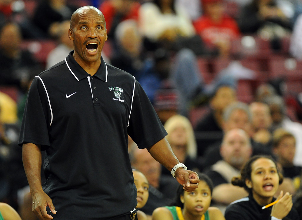 . Poly coach Carl Buggs watches the action from the sideline at Sleep Train Arena in Sacramento, CA on Saturday, March 29, 2014. Long Beach Poly vs Salesian in the CIF Open Div girls basketball state final. 2nd half. Poly won 70-52. (Photo by Scott Varley, Daily Breeze)