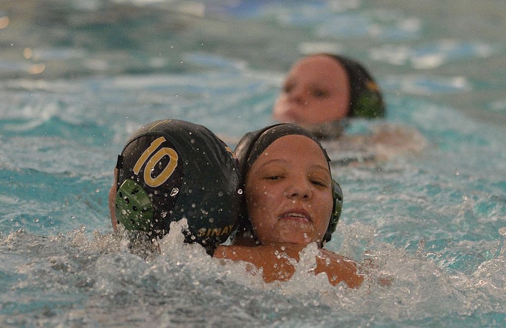 . LONG BEACH, CALIF. USA -- Poly\'s Shannon Darley (6) hugs teammate Angelika Sinay (10) after Sinay scored a goal against San Clemente during their CIF-SS first round game in Long Beach, Calif. on February 12, 2013. Poly lost to San Clemente, 7 to 6. Photo by Jeff Gritchen / Los Angeles Newspaper Group