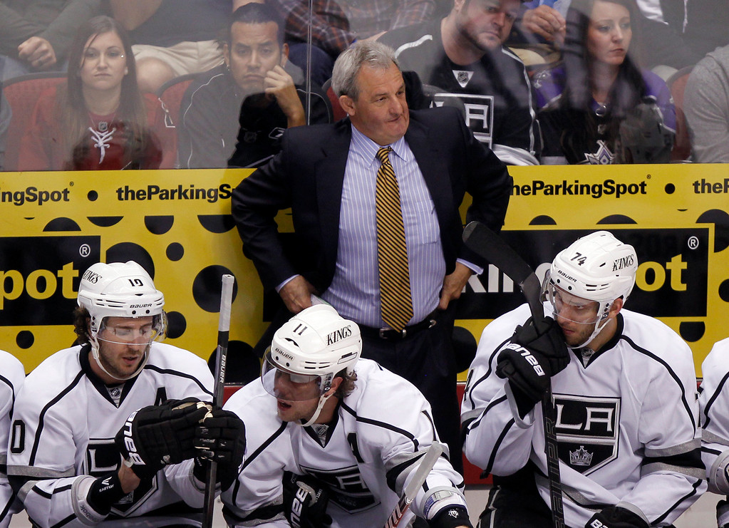 . Los Angeles Kings Darryl Sutter, standing, reacts as officials call a face-off in the Kings\' zone against the Phoenix Coyotes in the third period of an NHL hockey game Tuesday, April 2, 2013, in Glendale, Ariz. The Coyotes won 3-1. (AP Photo/Paul Connors)
