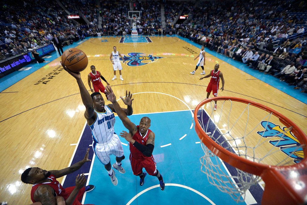 . New Orleans Hornets small forward Al-Farouq Aminu (0) shoots over Los Angeles Clippers small forward Caron Butler in the first half of an NBA basketball game in New Orleans, Wednesday, March 27, 2013. The Clippers won 105-91. (AP Photo/Gerald Herbert)