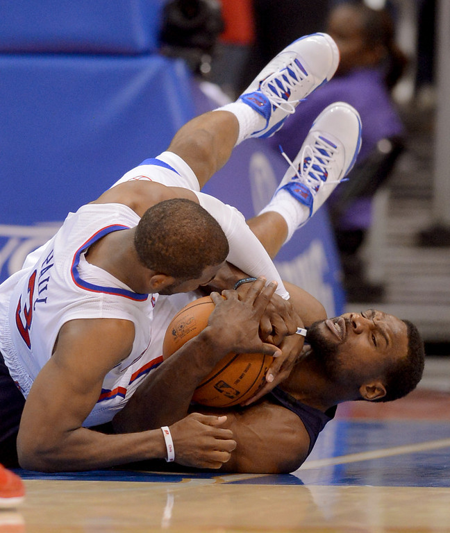 . Clippers guard Chris Paul and Tony Alllen of the Memphis Grizzlies battle for the ball during game 2 of the 2013 NBA Western Conference Playoffs April 22, 2013 in Los Angeles, CA.(Andy Holzman/Staff Photographer)