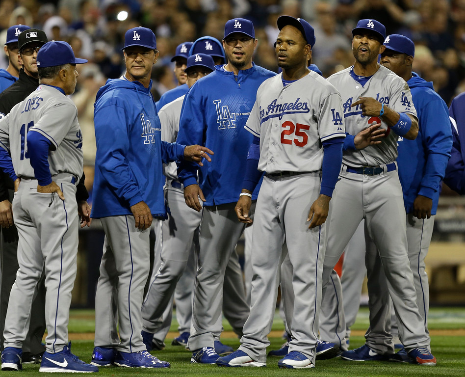. Los Angeles Dodgers\' Carl Crawford, (#25), Matt Kemp, right, Josh Beckett, third from left, and manager Don Mattingly, fourth from left, stand in front of the San Diego Padres dugout in a confrontation following a braw during the eighth inning of baseball game in San Diego, Thursday, April 11, 2013. The braw started when San Diego Padres\' Carlos Quentin was hit by a pitch from Dodgers pitcher Zack Greinke.  (AP Photo/Lenny Ignelzi)