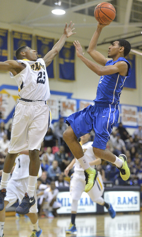 . LONG BEACH, CALIF. USA -- Millikan\'s Sidney Scott (23) tries to block Gahr\'s Malachi Hoosein (2) during their CIF-SS Divison 1-A playoff game in Long Beach on February 15, 2013. Millikan defeated Gahr, 74 to 64. Photo by Jeff Gritchen / Los Angeles Newspaper Group
