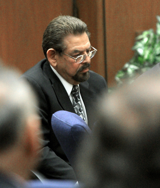 . George Mirabal,  a former Bell City elected official listens to the judge as a guilty verdict is read in his trial on Wednesday, March 20, 2013, in Los Angeles.  Mirabal and four former elected officials were convicted of multiple counts of misappropriation of public funds, and a sixth defendant was cleared entirely. Former Mayor Oscar Hernandez and co-defendants Mirabal, George Cole, Teresa Jacobo, and Victor Belo were all convicted of multiple counts and acquitted of others.  The charges against them involved paying themselves inflated salaries of up to $100,000 a year in the city of 36,000 people, where one in four residents live below the poverty line.   (AP Photo/Los Angeles Times, Irfan Khan, Pool)