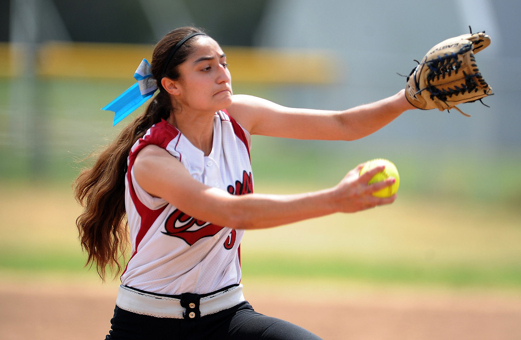 Description of . Covina starting pitcher Princess Nava throws to the plate in the first inning of the Northview Tournament championship softball game against Monrovia at Northview High School on Thursday, April 4, 2013 in Covina, Calif.  Monrovia won 6-0. 
