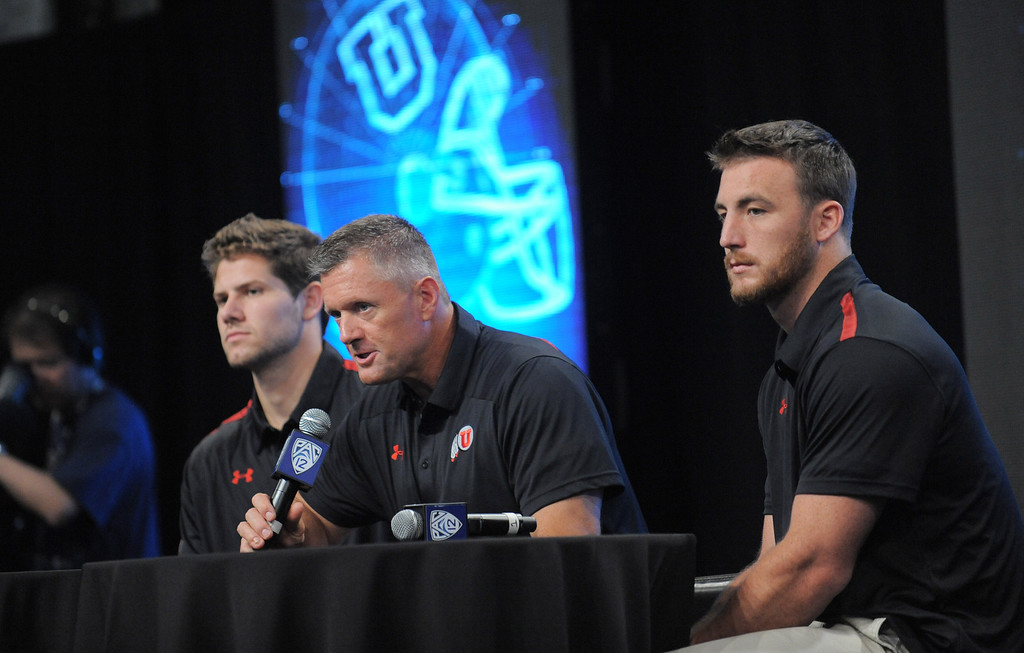 . Utah Coach Kyle Whittingham, center,  with players Jake Murphy, left and Trevor Reilly, right.Pac12 media Day at Sony Studios.  Photo by Brad Graverson 7-26-13