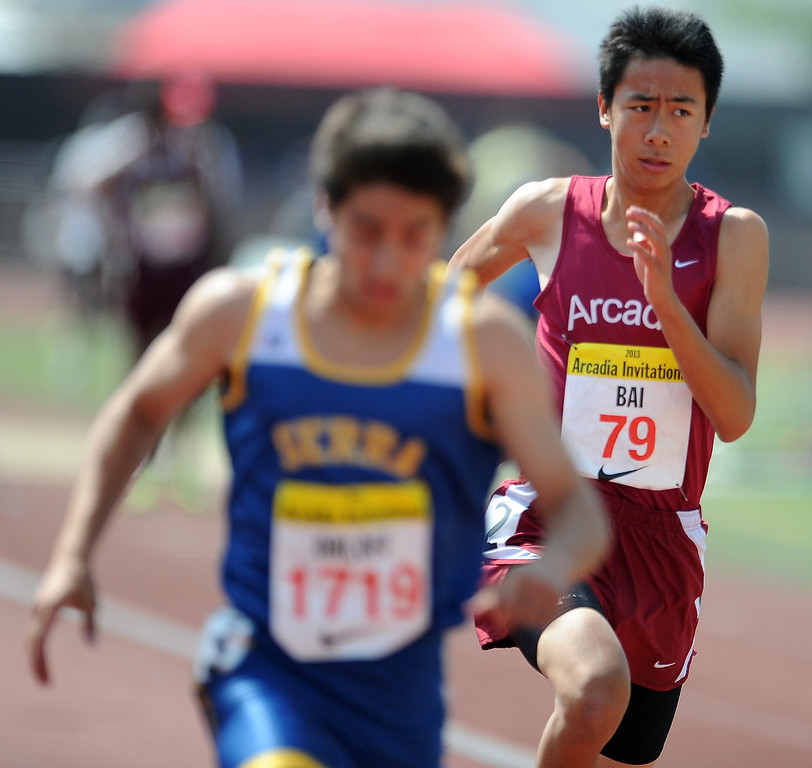 Description of . Arcadia's Vincent Bai competes in the 200 meters race in the during the Arcadia Invitational at Arcadia High School on Saturday, April 6, 2013 in Arcadia, Calif.  (Keith Birmingham Pasadena Star-News)
