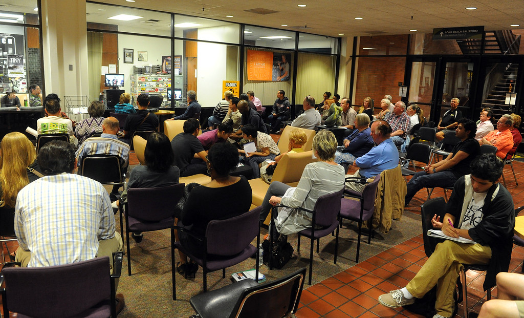 . An overflow crowd sits in the CSULB student union to watch a webcast of a mayoral debate at CSULB\'s Beach Auditorium in Long Beach, CA on Wednesday, March 19, 2014. Photo by Scott Varley, Daily Breeze)