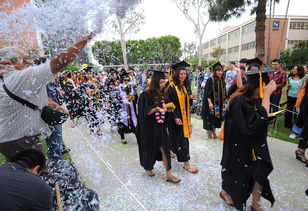 . LONG BEACH - 05/22/2013  (Photo: Scott Varley, Los Angeles News Group)  CSULB began with the first of nine graduation ceremonies that will take place through Friday on the upper campus quad. The College of Heath & Human Services were the first to graduate on Wednesday with student receiving their degrees in Communicative Disorders, Criminal Justice, Family and Consumer Sciences, Recreation and Leisure Studies and Social Work. Graduates are showered in confetti as they enter the ceremony.