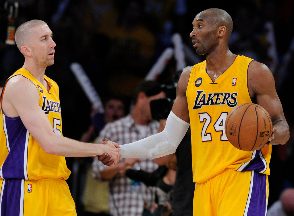 . Lakers#5 Steve Blake and Kobe Bryant shake hands after the game. The Lakers defeated New Orleans Hornets 104-96 in a game played at Staples Center in Los Angeles, CA 4/9/2013(John McCoy/Staff Photographer