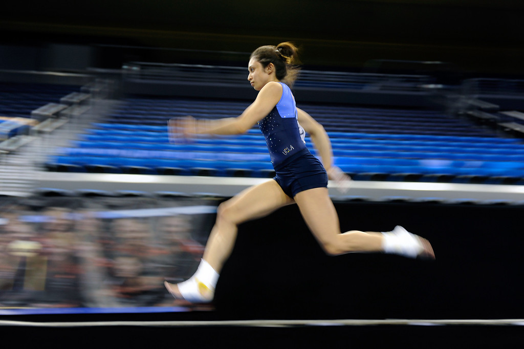 . UCLA Vanessa Zamarripa runs during a practice on the vault, Thursday, April 18, 2013, for the upcoming NCAA Women\'s Gymnastics Championships at Pauley Pavilion. (Michael Owen Baker/Staff Photographer)