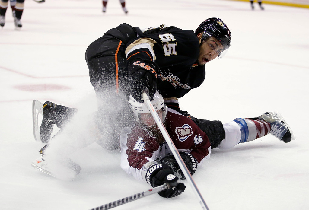 . Anaheim Ducks\' Emerson Etem, top, and Colorado Avalanche\'s Greg Zanon collide as they go after the puck during the second period of an NHL hockey game in Anaheim, Calif., Wednesday, April 10, 2013. (AP Photo/Jae C. Hong)