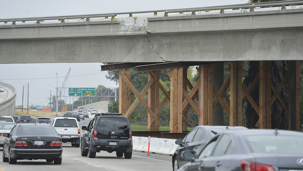 . SEAL BEACH, CALIF. USA -- Damage to the bridge that connects eastbound 7th. Street/Garden Grove (22) Freeway to northbound San Diego (405) and San Gabriel River (605) Freeways on March 18, 2013, in Seal Beach, Calif. The interchange was damaged when a piece of machinery weighing more than 100 tons fell off a big rig causing damage to the road, guardrail and bridge. Photo by Jeff Gritchen / Los Angeles Newspaper Group