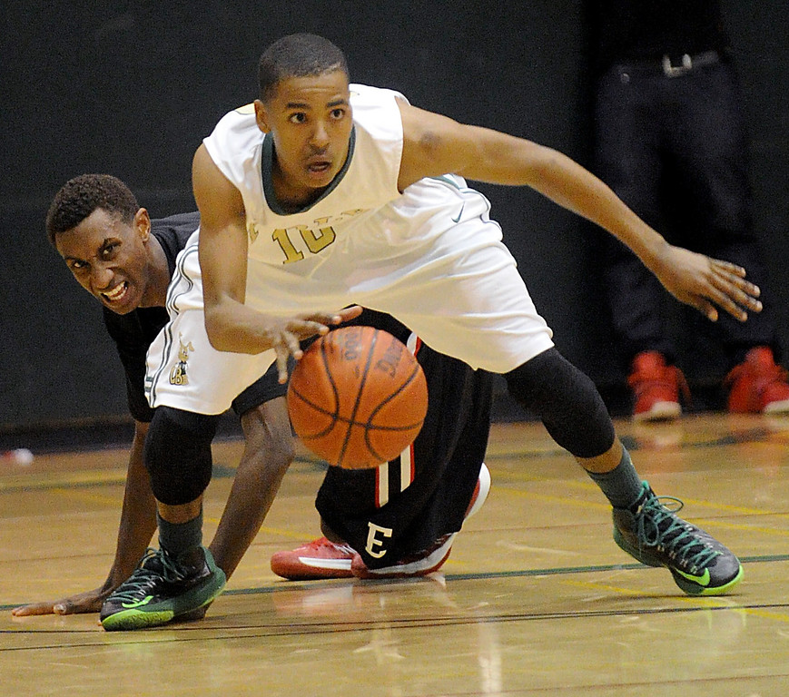 . 02-26-2012--(LANG Staff Photo by Sean Hiller)-Etiwanda beat Long Beach Poly 59-55 in Tuesday\'s CIF Southern Section Division 1AA semifinal boys basketball game at Long Beach Poly High School. Poly\'s Ke\'jhan Feagin (10) gets ahead of Etiwanda\'s Sheldon Blackwell (3).