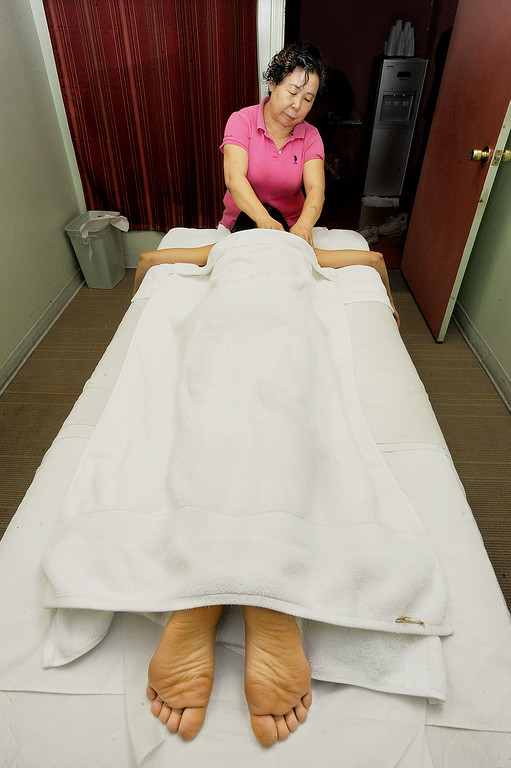 Description of . A massage being given in one of the rooms at LS Massage Acupuncture located at 301 West Valley Boulevard Wednesday, March 25, 2014. (Photo by Walt Mancini/Pasadena Star-News)
